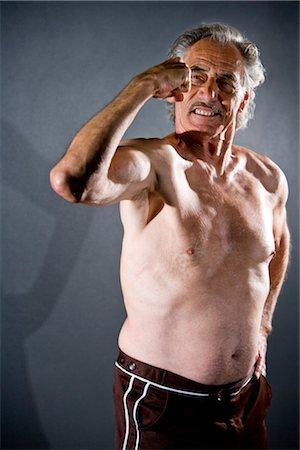 Senior man flexing muscles, studio shot Stock Photo - Rights-Managed, Code: 842-03200681