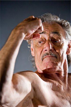 Senior man flexing muscles, studio shot Stock Photo - Rights-Managed, Code: 842-03200683