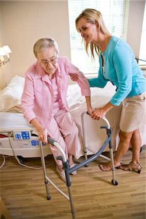 Adult daughter helping elderly mother use walker Stock Photo - Rights-Managed, Code: 842-03200770