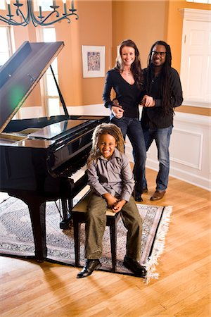 Interracial family gathered around piano Stock Photo - Rights-Managed, Code: 842-03200866