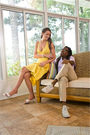 Portrait of mixed race couple relaxing in sunroom Stock Photo - Rights-Managed, Code: 842-03200874