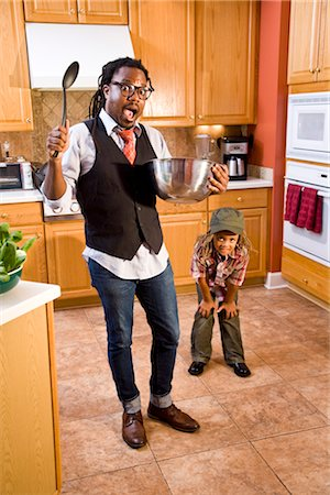 Father and son in kitchen having fun with mixing bowl and spoon Stock Photo - Rights-Managed, Code: 842-03200887