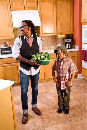 Little boy in kitchen staring at bowl of vegetables held by father Stock Photo - Rights-Managed, Code: 842-03200888
