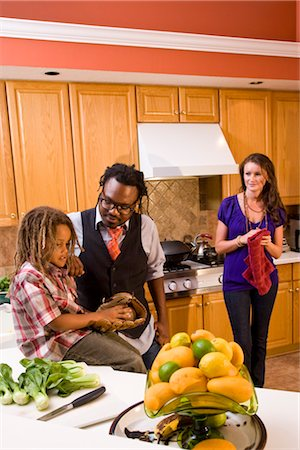 Interracial family in kitchen at home Stock Photo - Rights-Managed, Code: 842-03200892