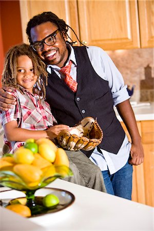 Jamaican father and young son together in kitchen Stock Photo - Rights-Managed, Code: 842-03200917