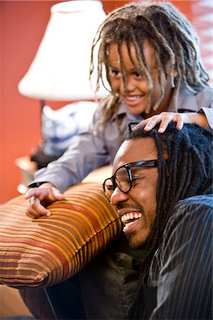 Jamaican father and son with dreadlocks at home Stock Photo - Rights-Managed, Code: 842-03200919
