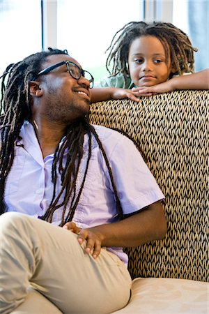 Jamaican father and young son with dreadlocks on sunroom on sofa Stock Photo - Rights-Managed, Code: 842-03200929
