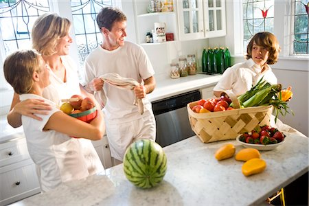 Young family in kitchen with fresh fruits and vegetables Stock Photo - Rights-Managed, Code: 842-03200975