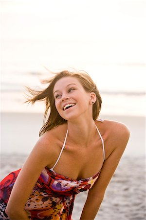 Young happy woman in colorful sundress standing on beach Stock Photo - Rights-Managed, Code: 842-03201034