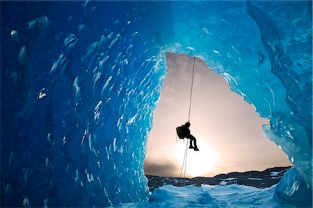 COMPOSITE: View from inside an ice cave of an iceberg frozen in Mendenhall Lake as an ice climber rappels down a rope, Juneau, Southeast Alaska, Winter Stock Photo - Rights-Managed, Code: 854-05974173