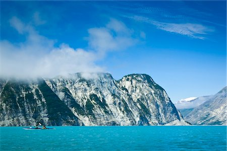 quest - Sea kayakers paddling along cliffs through Muir Inlet, Glacier Bay National Park & Preserve, Southeast Alaska, Summer Stock Photo - Rights-Managed, Code: 854-05974533