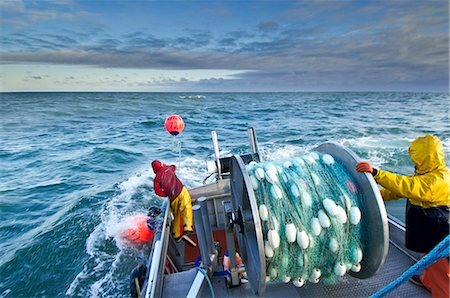 professional (pertains to traditional blue collar careers) - The crew casts out the first set of a gillnet in Ugashik Bay, Bristol Bay region, Southwest Alaska, Summer Stock Photo - Rights-Managed, Code: 854-05974556