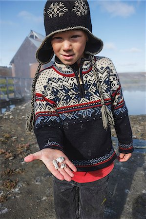 Boy In Hand-Made Nordic Sweater And Hat Shows The Rocks He Found At Serpentine Hot Springs, Bering Land Bridge National Preserve (National Park), Northwest Alaska, Autumn Stock Photo - Rights-Managed, Code: 854-08028181
