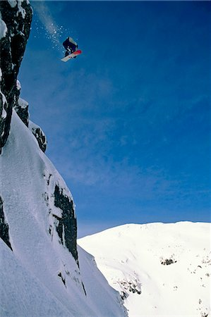 sports and snowboarding - Snowboarder in Mid-Air @ Eaglecrest Juneau Southeast Alaska winter scenic Stock Photo - Rights-Managed, Code: 854-02954862