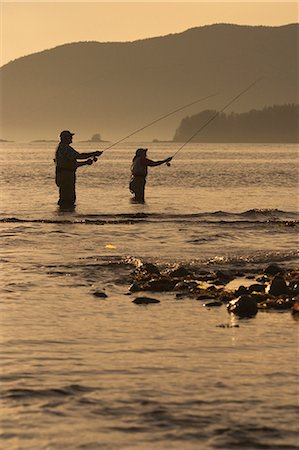 quest - Couple Flyfishing Shoreline of Sitka Sound Near Harbor Point in Southeast Alaska Stock Photo - Rights-Managed, Code: 854-02954951