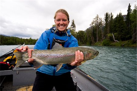 quest - Woman holding nice Rainbow Trout caught on Kenai River from Drift boat Kenai Peninsula Alaska Summer Stock Photo - Rights-Managed, Code: 854-02955002