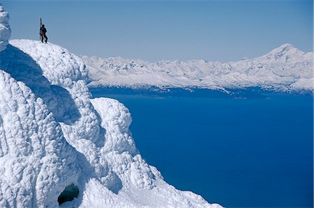 Mountaineer Standing on ridge viewing vast scenery from Augustine Volcano across Cook Inlet Alaska Stock Photo - Rights-Managed, Code: 854-02955049
