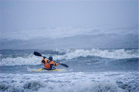 quest - Man kayak surfing in winter storm surf Kachemak Bay near Homer Kenai Peninsula Alaska Winter Stock Photo - Rights-Managed, Code: 854-02955110