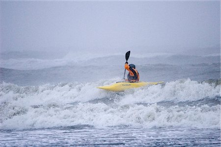 quest - Man kayak surfing in winter storm surf Kachemak Bay near Homer Kenai Peninsula Alaska Winter Stock Photo - Rights-Managed, Code: 854-02955111