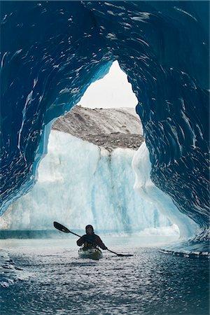 quest - Sea Kayaker paddles through an ice cave amongst giant icebergs near Bear Glacier in Resurrection Bay near Seward, Alaska Stock Photo - Rights-Managed, Code: 854-02955124