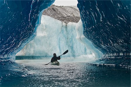 quest - Sea Kayaker paddles through an ice cave amongst giant icebergs near Bear Glacier in Resurrection Bay near Seward, Alaska Stock Photo - Rights-Managed, Code: 854-02955125