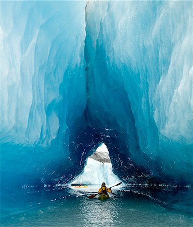 quest - Sea Kayaker paddles through an ice cave amongst giant icebergs near Bear Glacier in Resurrection Bay near Seward, Alaska Stock Photo - Rights-Managed, Code: 854-02955126