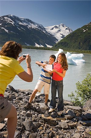 quest - Children pose with ice chunk along shore of Portage Lake on hike Chugach National Forest, AK Stock Photo - Rights-Managed, Code: 854-02955181
