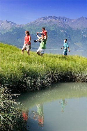 quest - Family hiking in meadow near Bird Point along Turnagain Arm, with Kenai Mtns background, AK Summer Stock Photo - Rights-Managed, Code: 854-02955182