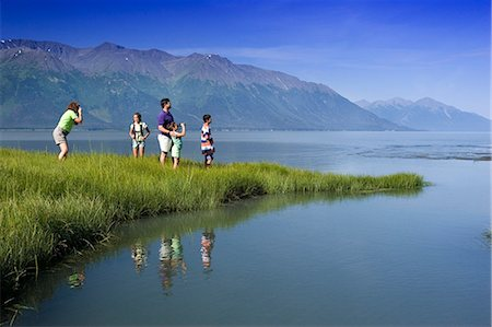 quest - Family hiking in meadow near Bird Point along Turnagain Arm, with Kenai Mtns background, AK Summer Stock Photo - Rights-Managed, Code: 854-02955183