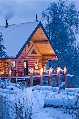 Log Cabin in the woods decorated with Christmas lights at twilight near Fairbanks, Alaska during Winter Stock Photo - Rights-Managed, Code: 854-02955486