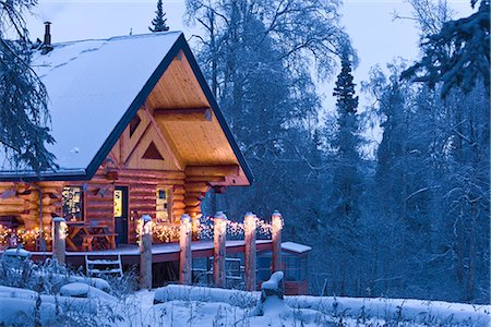 Log Cabin in the woods decorated with Christmas lights at twilight near Fairbanks, Alaska during Winter Stock Photo - Rights-Managed, Code: 854-02955487