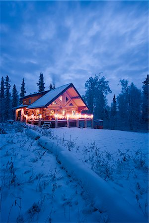 Log Cabin in the woods decorated with Christmas lights at twilight near Fairbanks, Alaska during Winter Stock Photo - Rights-Managed, Code: 854-02955488
