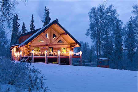 Log Cabin in the woods decorated with Christmas lights at twilight near Fairbanks, Alaska during Winter Stock Photo - Rights-Managed, Code: 854-02955489