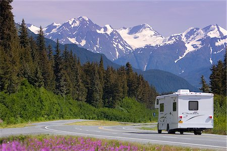 quest - Motorhome passes a field of Fireweed as it drives down the Seward Highway near Turnagain Pass. Summer on the Kenai Peninsula of Southcentral Alaska. Stock Photo - Rights-Managed, Code: 854-02955737