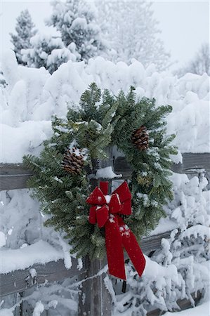 Holiday christmas wreath hanging on snow covered split rail fence Anchorage Alaska Southcentral Winter Stock Photo - Rights-Managed, Code: 854-02955786