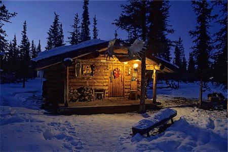 Interior Alaska Log Cabin Forest Winter Porch Light Snow Sky Dusk Stock Photo - Rights-Managed, Code: 854-02955828