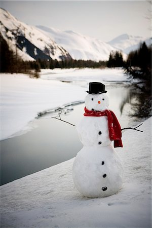 Lighted snowman decoration standing on riverbank Alaska Winter Stock Photo - Rights-Managed, Code: 854-02955837