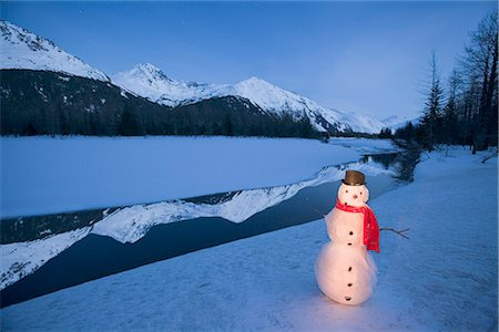 Lighted snowman decoration standing on riverbank Alaska Winter Composite Stock Photo - Rights-Managed, Code: 854-02955838