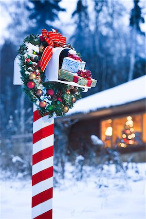 Mailbox decorated for Christmas with wreath and candy cane striped post in front of log home in Fairbanks, Alaska Stock Photo - Rights-Managed, Code: 854-02955854