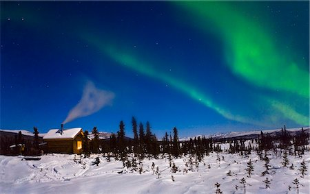 Northern lights in the sky above a moonlit cabin. White Mountain Recreation area during Winter in the Interior of Alaska. Stock Photo - Rights-Managed, Code: 854-02956103