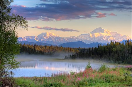 View of southside of Mt. McKinley, Mt. Hunter and Alaska Range with misty lake in the foreground  Southcentral, Alaska Stock Photo - Rights-Managed, Code: 854-03466930