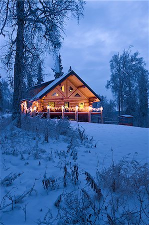 Log Cabin in the woods decorated with Christmas lights at twilight near Fairbanks, Alaska during Winter Stock Photo - Rights-Managed, Code: 854-03538489