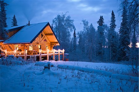 Log Cabin in the woods decorated with Christmas lights at twilight near Fairbanks, Alaska during Winter Stock Photo - Rights-Managed, Code: 854-03538490