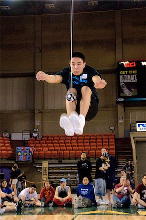 Boy doing Two-Foot High Kick 2006 Senior Native Youth Olympic Games Alaska Anchorage Sullivan Arena Stock Photo - Rights-Managed, Code: 854-03538942