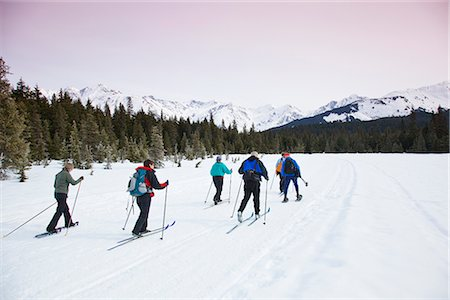 small town snow - A group of friends cross country ski and snowshoe on the multi-use Moose Meadow trail near the Alyeska Hotel in Girdwood, Alaska, Spring Stock Photo - Rights-Managed, Code: 854-03645832