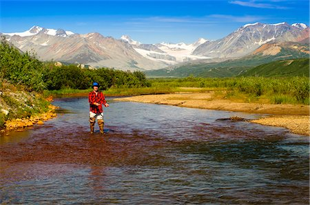 Man fly fishing in Gunn Creek off the Richardson Highway with Gulkana Glacier and the Alaska Range in the background, Interior Alaska, Summer Stock Photo - Rights-Managed, Code: 854-03645858
