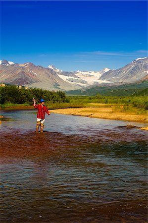 road landscape - Man fly fishing in Gunn Creek off the Richardson Highway with Gulkana Glacier and the Alaska Range in the background, Interior Alaska, Summer Stock Photo - Rights-Managed, Code: 854-03645859