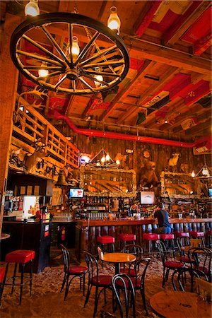saloon - Tourist sits at the bar of the Red Dog Saloon in Juneau, Southeast Alaska, Summer Stock Photo - Rights-Managed, Code: 854-03646299