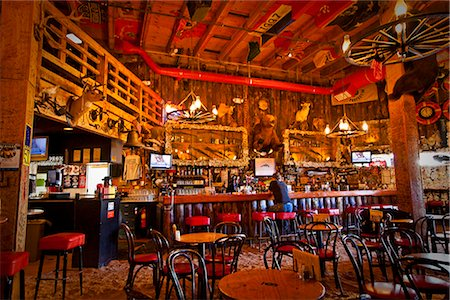 saloon - Tourist sits at the bar of the Red Dog Saloon in Juneau, Southeast Alaska, Summer Stock Photo - Rights-Managed, Code: 854-03646300