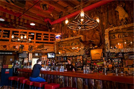saloon - Tourist sits at the bar of the Red Dog Saloon in Juneau, Southeast Alaska, Summer Stock Photo - Rights-Managed, Code: 854-03646301